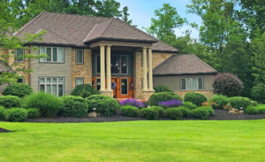 home with stone exterior and large porch columns in Barrington Estates